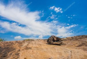 depositphotos_78874854-stock-photo-stone-and-blue-sky